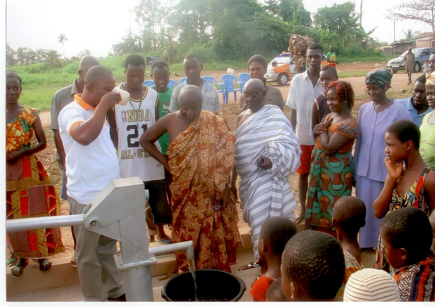 THE ASSEMBLY MAN TESTING THE WATER FROM THE BOREHOLE
